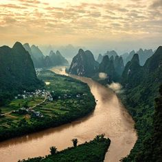 """The sun rising over Li River, China. One of the world's """"Top 10 Watery Wonders"""", the Li River has the most popular and picturesque scenery in China. The best way to appreciate the beautiful scenery of a river is to take a cruise. The cruise from Guilin to Yangshuo is one of the most popular activities in a Guilin holiday. Photo by king_roberto via Instagram #amitrips #travel #asia #nature"""