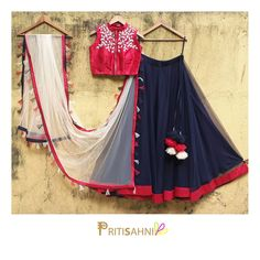 Twirling with tasselsPlay your cool chic card in this navy blue skirt with crimson raw silk embroidered crop top and dupatta with colorful tassels .For more information Whatsapp on 27 September 2017 Half Saree Designs, Choli Designs, Lehenga Designs, Blouse Designs, Indian Wedding Outfits, Indian Outfits, Indian Clothes, Indian Dresses, Indian Attire