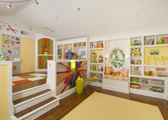 What an awesome play room! Notice the puppet theater in the corner.