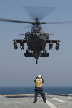 A U.S. Army AH-64D Apache helicopter hovers above the flight deck of the USS Ponce. (U.S. Navy photo by Mass Communication Specialist 1st Class Michael Sandberg/Released)