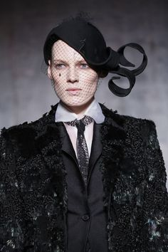 Thom Browne F/W 2015, at NYFW. Whales on the headpiece, and a mesh-y tie.