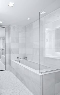 The Laurel | Upper East Side, NYC Architecture Design, Minimalist Bathroom Design, White Bathrooms, Upper East Side, Bedding, Tile, Household, Bathtub, Nyc