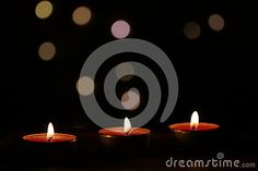 Red Christmas candles on dark background