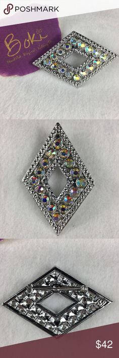 """Vintage Aurora Borealis Diamond-shaped Brooch This pristine vintage brooch in silver-tone features stunning array of aurora borealis stones. Stones have wonderful fire and pick up a rainbow of colors from the light. This gorgeous piece would be perfect as a scarf clasp or worn on a lapel either east to west or north to south. Maker mark appears to have an """"A"""" and possibly a """"C"""" - difficult to make out. See pics for size. From family collection, smoke free home. Vintage Jewelry Brooches"""