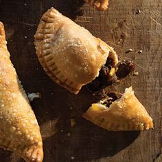 Beef Brisket and Picadillo-Stuffed Empanadas: Tender braised beef brisket is combined with raisins, sherry, pine nuts, and spicy chile powder in the fragrant filling for sugar-dusted, savory-sweet empanadas. Beef Empanadas, Empanadas Recipe, Mexican Food Recipes, Beef Recipes, Cooking Recipes, Mexican Dishes, Easy Recipes, Saveur Recipes, Mexican Meals