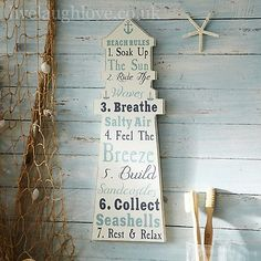 Wooden lighthouse plaque which will give you a list of your favourite seaside things from donkey rides to fish and chips this wooden sign says it all. This would look good in a beach themed room.