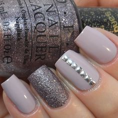 Purple leaning taupe base with purple-grey textured accent and studs. | Nicole by O.P.I. 'Am I Making Myself Claire?' and O.P.I. 'Baby Please Come Home' on the ring finger accent nail.
