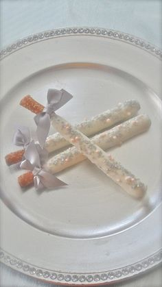 Edible Wedding Favors Silver and Pink Chocolate Dipped Pretzel Rods Frost the Cake. $21.00, via Etsy.