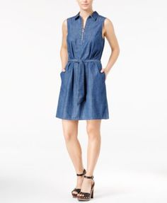 Tommy Hilfiger updates the shirtwaist silhouette with a zipper closure and a light denim wash. | Cotton | Machine washable | Imported | Point collar | Half-zipper closure at front  | Sleeveless | Self