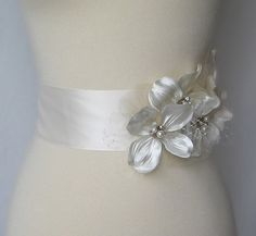 I love the dogwood flowers on the belt.  I would like to see this in a more delicate fabric with lace accents.