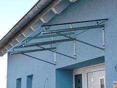 Edelstahlvordach Athen - ein Echtglas Haustürvordach mit Edelstahlhalterungen aus Rohr- und Massivstahl.