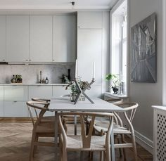 Peek Into a Stylish Gothenburg Apartment with a Delicate Palette and Some Noteworthy Design Elements