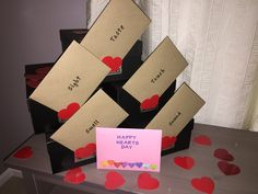 My swing at the 5 senses Valentine gift.   Each box contains a gift for each of his 5 senses   Touch : soft t-shirts wrapped in tissue and sprinkled with hand cut heart confetti   Taste: 4 containers of chocolate covered treats drizzled in red confetti and hearts  Sound: a new pair of Bose headphones   Sight: handmade deck of cards with reasons why I love him surrounded by Polaroids of he and I.   Smell: mancrate container of coffees and accessories.   Each card has the definition and a note
