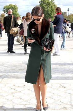 Mira Duma in green coat with mink collar