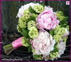 A soft and romantic, fresh floral, hand-tied, bridal bouquet in shades of pink and green. Peonies, viburnum, and genuine Swarovski crystals make this simple bridal bouquet spectacular.