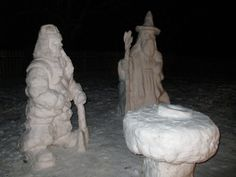 Gandalf and Gimli molded from snow.