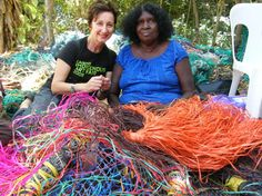 Ingrid Hoffman (Arts QLD) and Mavis Ngallametta (Aurukun) CIAF Ghost Net display 09.  photo courtesy Gina Allain