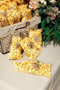 Popcorn: http://www.stylemepretty.com/2015/06/28/15-delicious-wedding-food-favors/