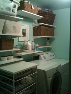 Pinterest ideas + Serendipity paint + Red accents + Elfa = My new lovely laundry room!