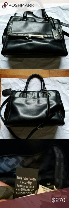 Diane Von Furstenburg studded black leather tote 100% authentic black leather studded satchel by DVF .  $500 retail. Good condition, a once over with leather cleaner will have it looking like new!  Comes with white dust bag.   Height: 9in Length: 16in Depth: 6in Strap drop: 22in Handle drop:6 in Diane von Furstenberg Bags Satchels