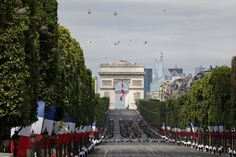 Bastille Day by Mal Langsdon - Troops march down the Champs-Elysees avenue during the traditional Bastille Day military parade in Paris