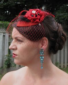Rich red with a hint of black. Satin fleur with feathers, bling & some red Russian veil. This is my personal fascinator on a very comfortable headband. NFS but can be ordered.