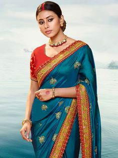 Traditional yet chic this beautiful saree is a must have in your wardrobe. This blue silk saree com. Embroidered Clothes, Embroidered Silk, Blue Silk Saree, Top Wedding Dress Designers, Teal Blue Color, Colour, Latest Sarees, Saree Wedding, Wedding Wear