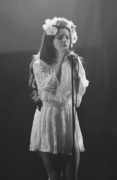 Black And White Photography // one of Lana Del Rey's best flower crowns  Lana performing in a white lace dress