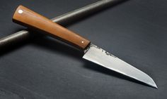 K&T Paring Knife, handmade in France by Bryan Raquin using san mail steel and vintage micarta.