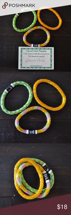 Lily & Laura Roll On Nepal Bracelet Bright Set Lily & Laura Roll On Nepal Bracelet Set of 3 Glass Beads in Pink, Green & Yellow. These bracelets are a fair trade product made by women in Nepal to help sustain their families. They fit virtually every wrist simply by rolling on. Because of how they are crocheted they expand & retract by rolling, & will not break unless cut. As each are handmade, they may vary slightly in size. Each one is unique. They are stack-able & mix-and-matchable. Please…