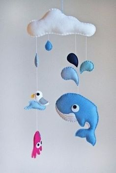 Early mobiles did not necessarily move, as do most crib mobiles today. The modern crib mobile is… Felt Mobile, Baby Crib Mobile, Felt Animal Patterns, Stuffed Animal Patterns, Felt Crafts, Diy And Crafts, Baby Crib Diy, Mobile Project, Wooly Bully
