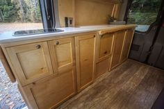 This van conversion was built for taking extended weekend trips, with a double drop down bed, large kitchen galley, and a modular bench seat with a dog bed. Van Conversion Build, Van Conversion Interior, Camper Van Conversion Diy, Sprinter Conversion, Motorhome, Tiny House Big Living, Small Living, Kitchen Cooker, Build A Camper Van