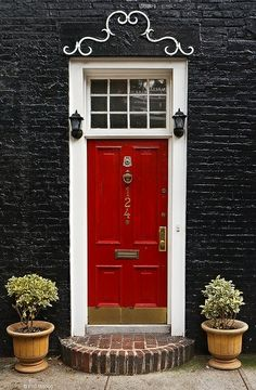A red door and black bricks