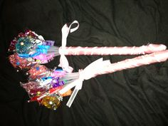 Lollipop flower bouquet  Made this for my daughters ballet recital. Super simple. Flower lollipops wrapped in pink ribbon. I chose a ribbon with thin wire for hold.