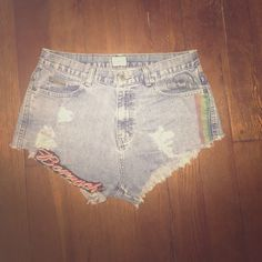 Captain Klein High Waisted Shorts Handmade cut off shorts with studded and paisley-ish back pocket. Boracha is stitched into the front with a rasta stripe on the other side. These were by go to beach party shorts but don't fit anymore!:( Size 9/10 would fit comfortably. Just the right length for those showing off a nice rump ;) Calvin Klein Shorts Jean Shorts