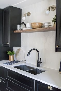 love the hex tile in this black and white kitchen's backsplash