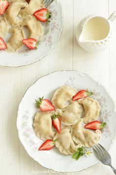 Polish PIEROGI - dumplings with strawberry filling and cream