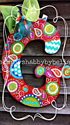 Personalized Initial Wood door hanger These letters are hand painted with acrylic paint & accented with glitter puffy paint . Letter Door Hangers, Initial Door Hanger, Door Letters, Burlap Door Hangers, Wooden Hangers, Initial Letters, Kids Letters, Painting Wooden Letters, Monogram Painting