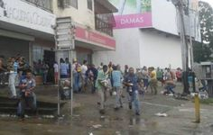 This is a picture of people ransacking stores in Venezuela. Venezuela doesn't have enough food. Venezuela makes most of its money from oil. In the past the price of oil has decreased so the government isn't making enough money. Venezuela's government makes prices of the food and in some cases the price of selling the food became lower than the cost to make it. So many people stopped making food in Venezuela. So people don't have the food they need to live. People have resulted to sacking…