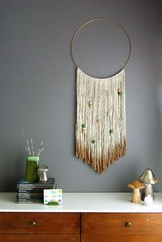 This yarn hanging would be super easy to make. I love the gold bit. Via Oleander + Palm, link: http://www.oleanderandpalm.com/2014/11/diy-gold-dipped-yarn-hanging.html