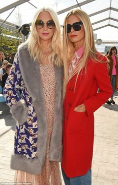 Poppy Delevingne and Laura Bailey pose ahead of the show on a sunny Sunday afternoon...