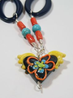 Flying Heart Lampwork Glass Pendant with Beaded and WIre Wrap Necklace. $35.00, via Etsy.