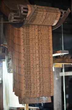 Punch card in an old jacquard loom.:
