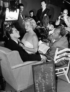 Robert Wagner with a seductive Marilyn Monroe on his lap during a test scene for Let's Make It Legal on June 14, 1951. Wagner was the 'test boy' for Fox at the time and played the male lead for actresses being screen tested for possible contracts. Their film careers took off at the same time and were receiving 5,000 fan letters a week