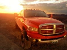 lifted red dodge ram truck