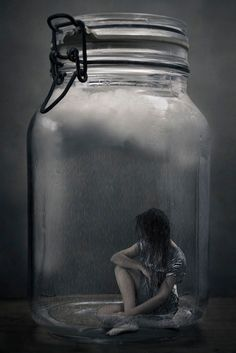 This picture of a woman trapped inside a butterfly jar.  This is similar to Miranda being trapped by Clegg like one of his butterflys.