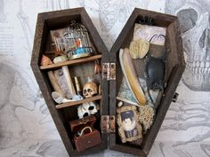 The Sea Captains Coffin is 6 tall. It holds items he has collected during his many voyages.  These include; a colourful bird in a cage, sea shells,