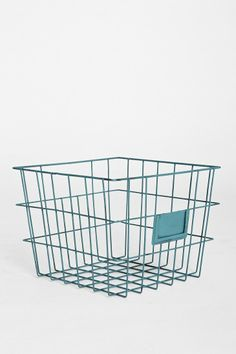 Wire basket for magazines in living room.  From Urban Outfitters.    Is there one we can use in the bathroom?