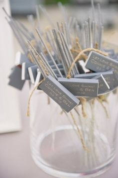 LOVE this wedding favor idea. Sparklers w/ matches.