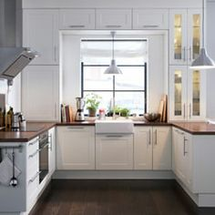 adel, cabinets over sink - I rather like this idea, I'd use the out-of-reach cabinets for 'entertaining crockery'.